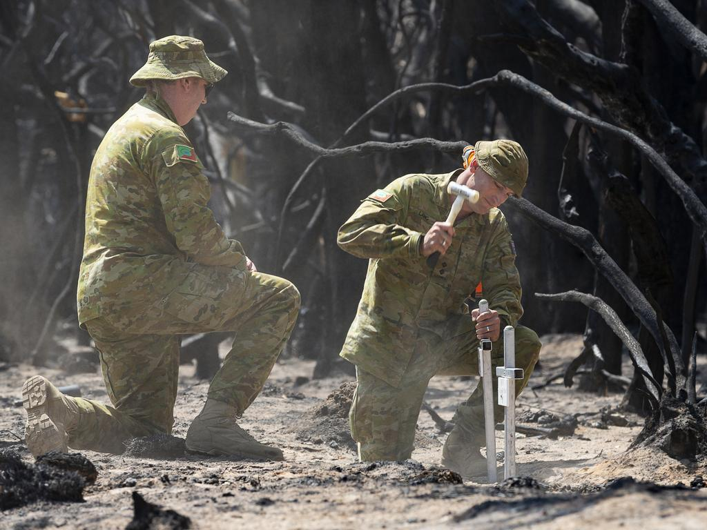 Lieutenant Kynan Lang from the 10th/27th Battalion visits the scene where his uncle and cousin died in a bushfire to place a memorial on Kangaroo Island.