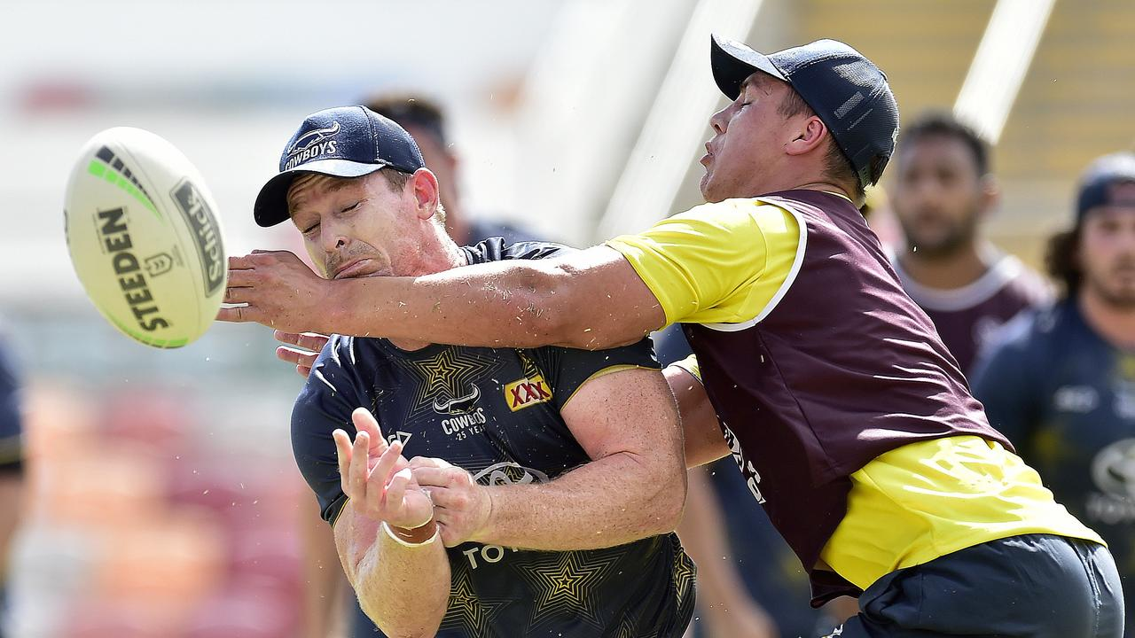 Scott Drinkwater clashes with possible new halves partner Michael Morgan. Picture: Matt Taylor.