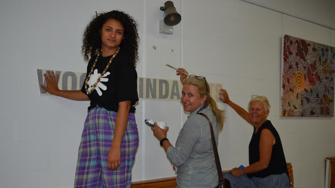 SHOWCASE: Nikeema Williams, Anita Milroy, and Julie Barratt preparing for the upcoming art showcase.