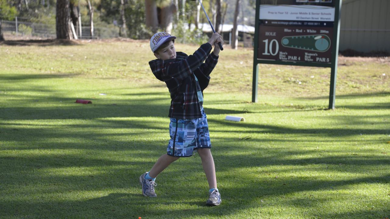 LOOKING TO THE FUTURE: Ryan Fischer follows through after his drive at the Warwick Golf Club in the junior league.