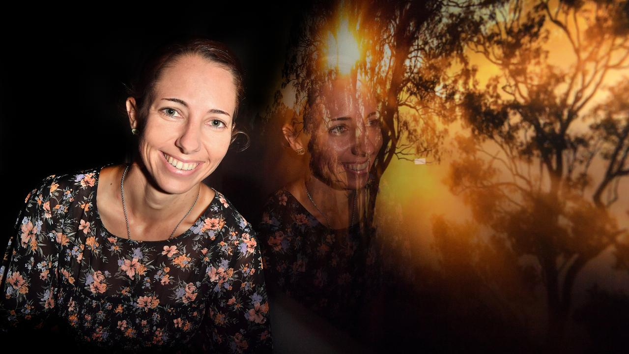 LIGHT UP: Photographer Nicola Brander with one of her magnificent works that brighten the walls of Caloundra Health Service Dove Palliative Care facility. Photo: John McCutcheon