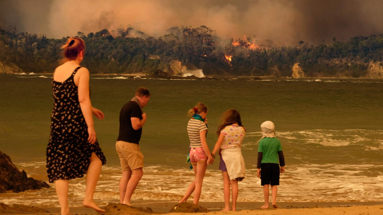 Bushfire arrives into the township of Malua Bay NSW, just south of Batemans Bay. NYE locals seek refuge on the beach. Picture: Alex Coppel.