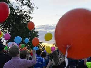 Residents gather for touching tribute after teen's death