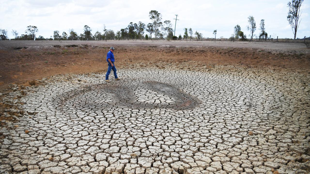 Russ Tindall walks around one of the dry dams on his Ridgelands property. Photo Allan Reinikka.