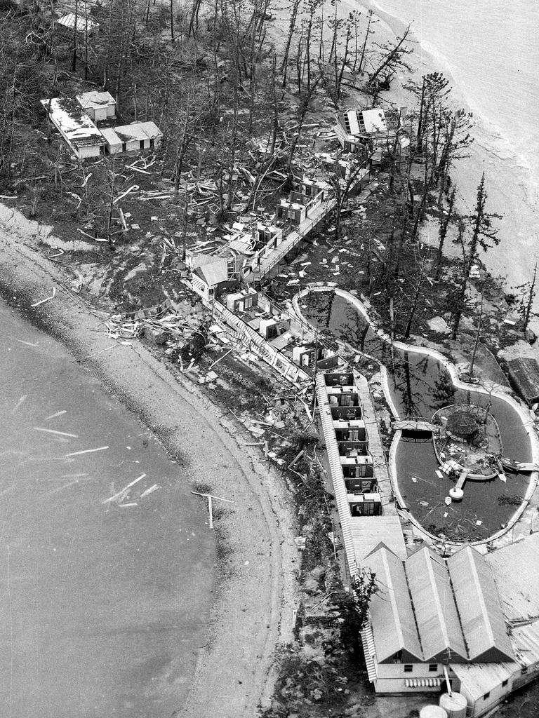 Devastation on Daydream Island where the tourist resort was virtually wiped out by Cyclone Ada on January 18, 1970. This aerial image shows all guest accommodation smashed and only the main hall standing (bottom right). About 140 guests were evacuated after the cyclone, which hurled debris, smashed glass, tore down buildings, and stripped trees of their foliage. Picture: Barry Pascoe.