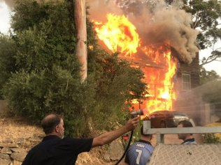 A house has been completely destroyed by fire in Coromandel Valley. It's one of three blazes that firefighters attended in the metropolitan Adelaide area overnight. Pic: Peter Caldicott/ Seven News