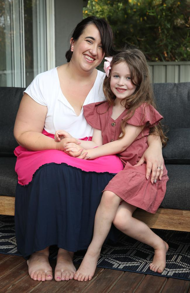 Sara Keli, with her daughter, Olivia, six, supports the new government online safety campaign to teach kids early about online predators. Picture: David Swift.
