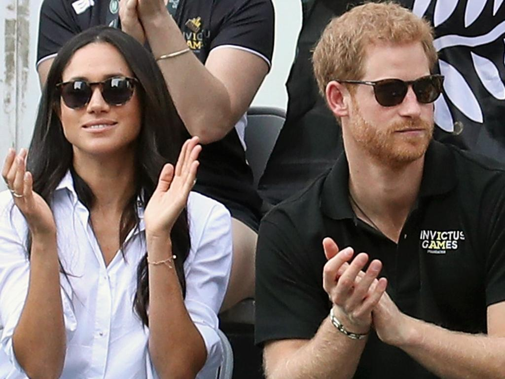 Prince Harry (R) and then-girlfriend Meghan attend a wheelchair tennis match during the Invictus Games 2017. Picture: Getty