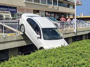 Car crashes through railing over embankment