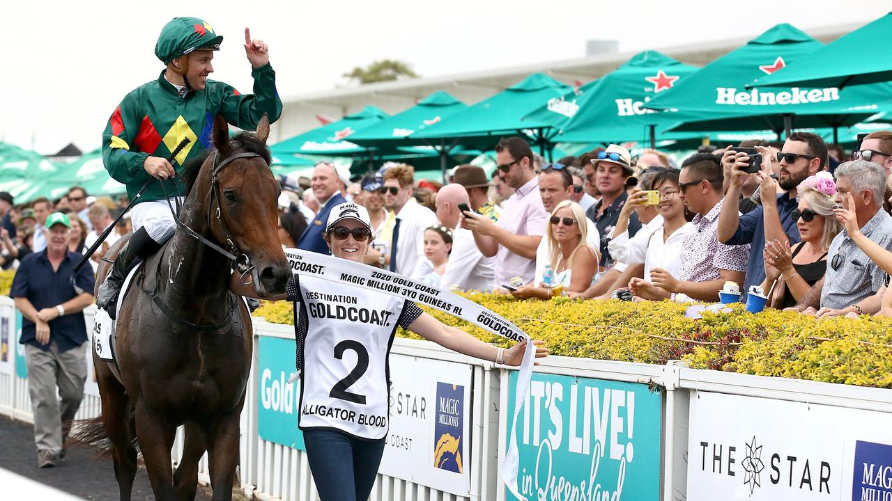 Jockey Ryan Maloney celebrates after riding Alligator Blood to victory in race 6, the Magic Millions 3YO Guineas, during Magic Millions Race Day at Aquis Park on the Gold Coast. (AAP Image/Jono Searle)