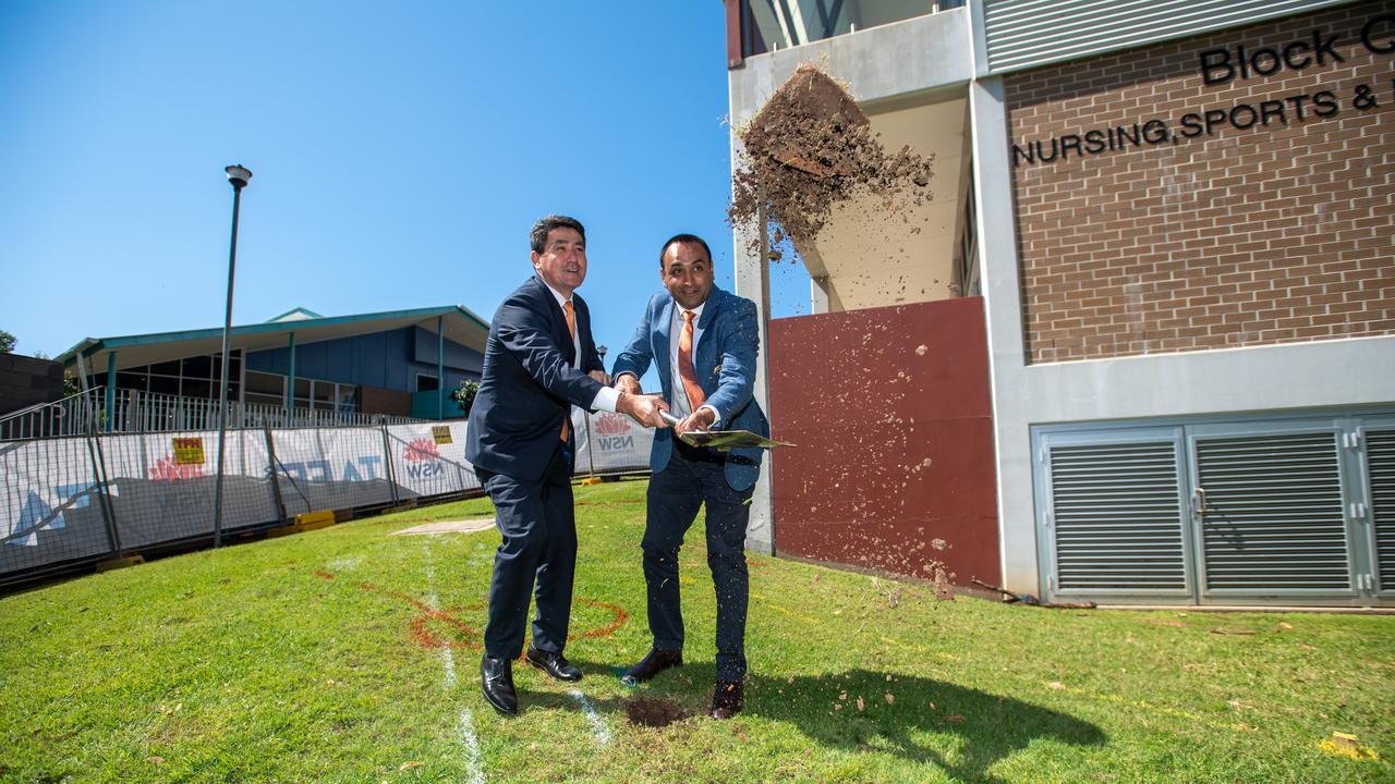 Minister for Skills and Tertiary Education Dr Geoff Lee and Member for Coffs Harbour Gurmesh Singh turn the first sod for the CHEC Trades Hub.