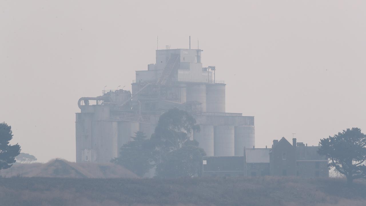 Smoke haze engulfs the Fyansford cement work silos. Picture: Alison Wynd