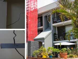 Watchdog wants power to stop builder over unit cracks