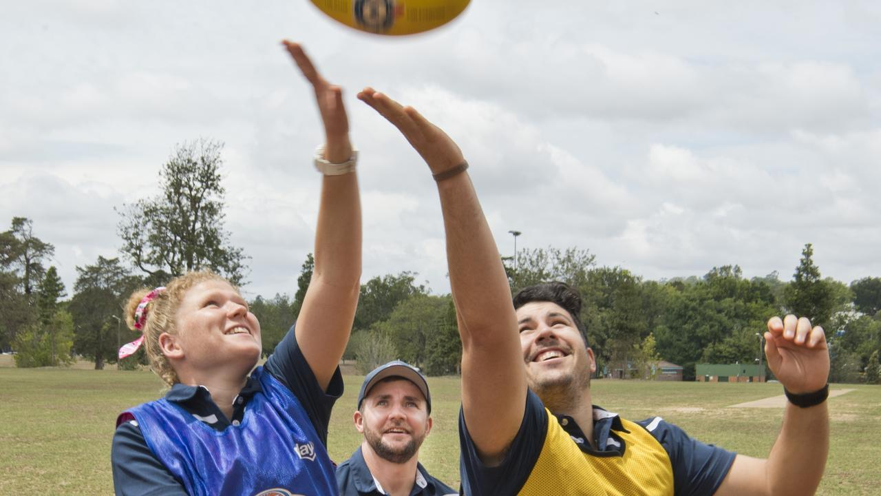 BALL UP: Meg Pullinger, Jeff Neumann (centre) and Mitchell Simpson prepare for the AFL Darling Downs Picnic Nines. Photo: Nev Madsen