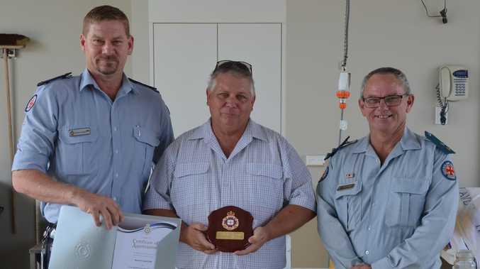 Ambulance volunteer with 'half a haircut' awarded