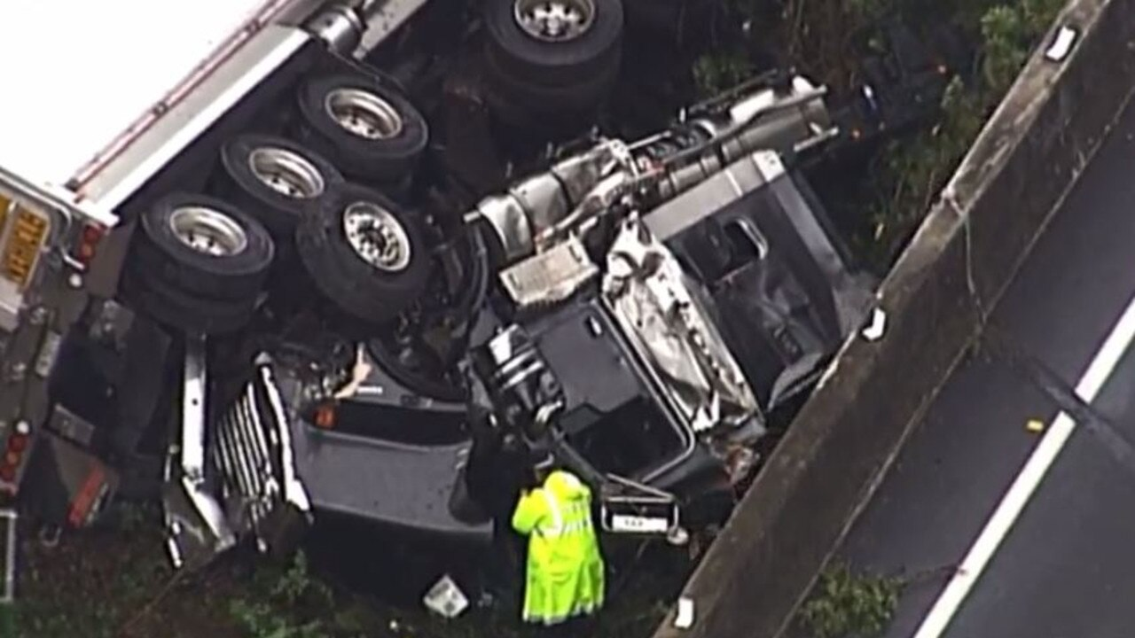 A truck has crashed off the Gateway Mwy in Brisbane, causing major delays. Picture: 7 News Queensland