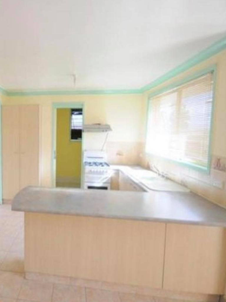Before: The kitchen featured a colour scheme of yellow and green. Picture: Supplied/Tricia Montgomery