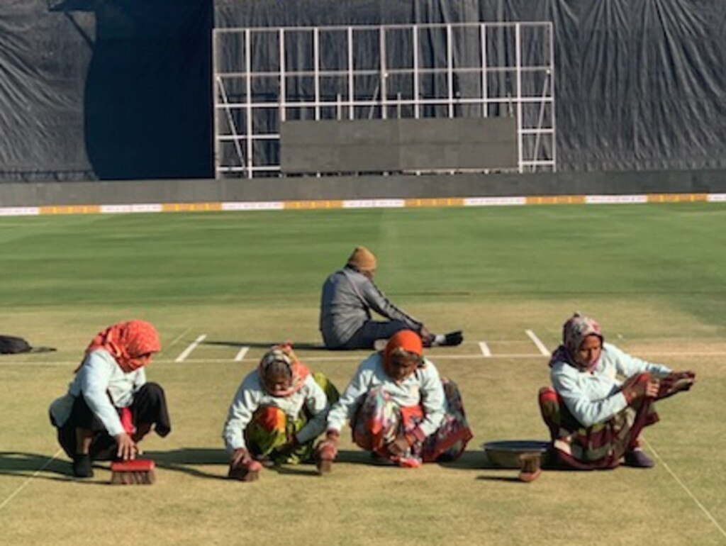The locals help prepare the wicket at Rajkot, India ahead of Friday's second ODI.