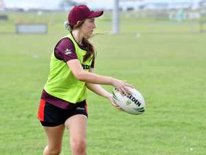 Ruby Phillips , 14, looks for a runner to offload the