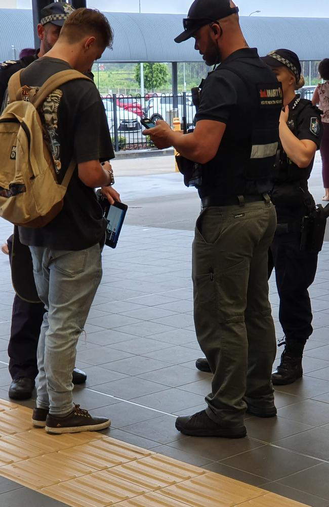 Police check IDs and tickets of young teenagers.