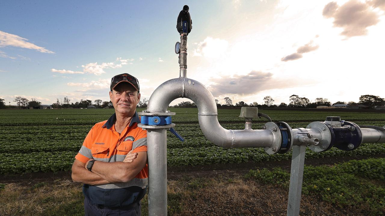 PRODUCE: Vegetable farmer Anthony Staatz, with government water meter near his crop of Cos Lettuce, owner of Koala Farms, at Lake Clarendon in the Lockyer Valley. PHOTO: Lyndon Mechielsen/The Australian