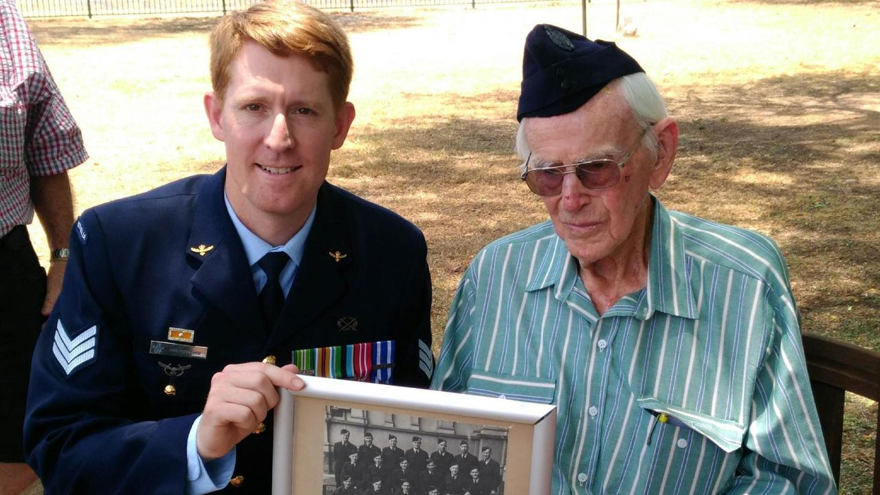 SGT Luke Goddard with Alan Willis at a celebration of Mr Willi's 100th birthday. Alan is wearing his original Air Force cap.
