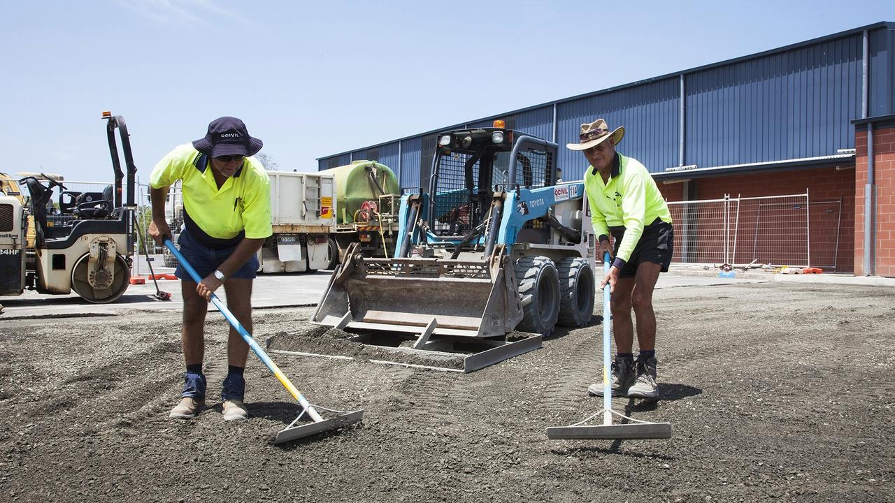 QCivil's Rod Frohloff (left) and Rob Barlow work on the Yarrilee School carpark extension.
