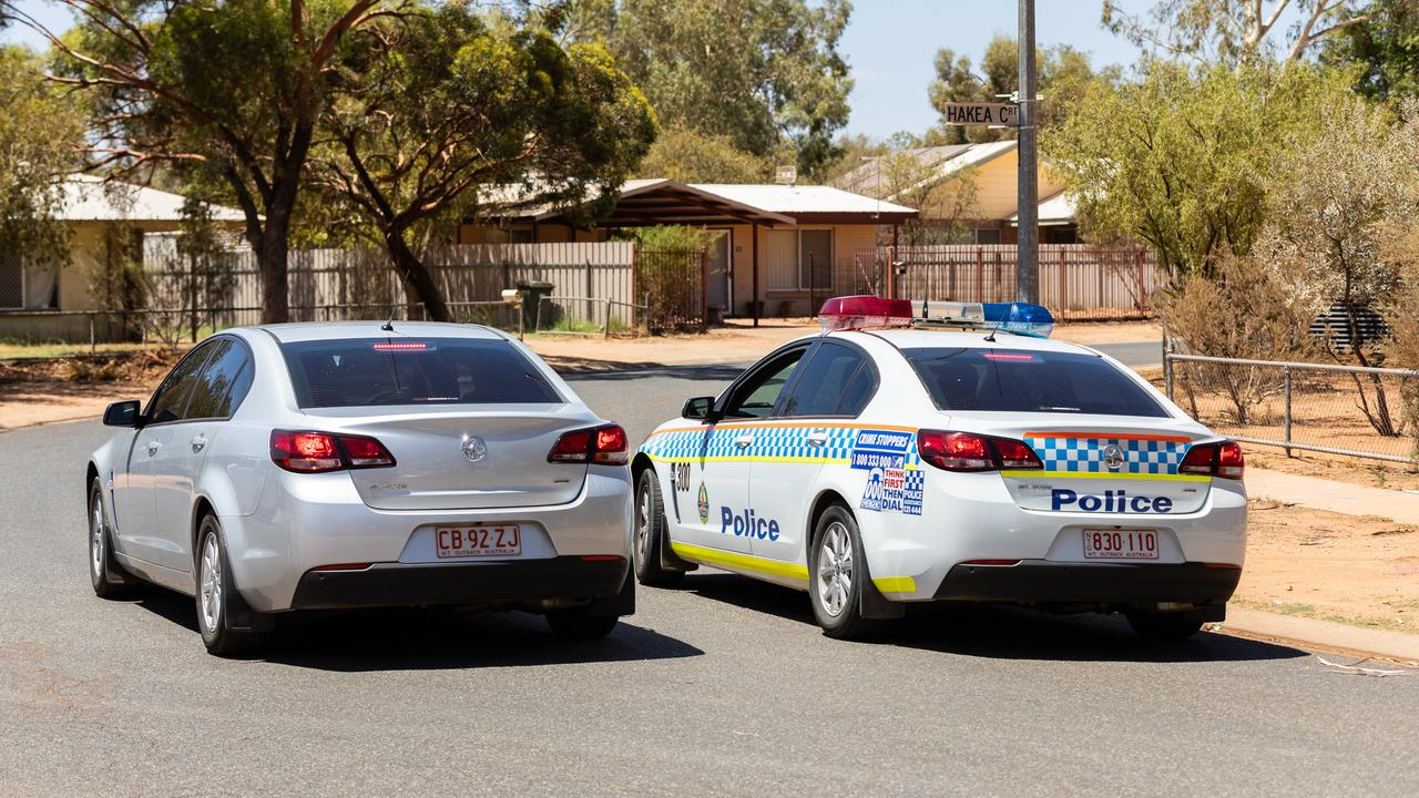 Police officers in marked and unmarked vehicles pause to talk to each other near Hakea Court in Sadadeen during a search for a man who fled the Alice Springs court house on Friday morning. The man was seen jumping fences in the area. Picture: Emma Murray