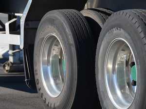 Log truck rollover shuts highway