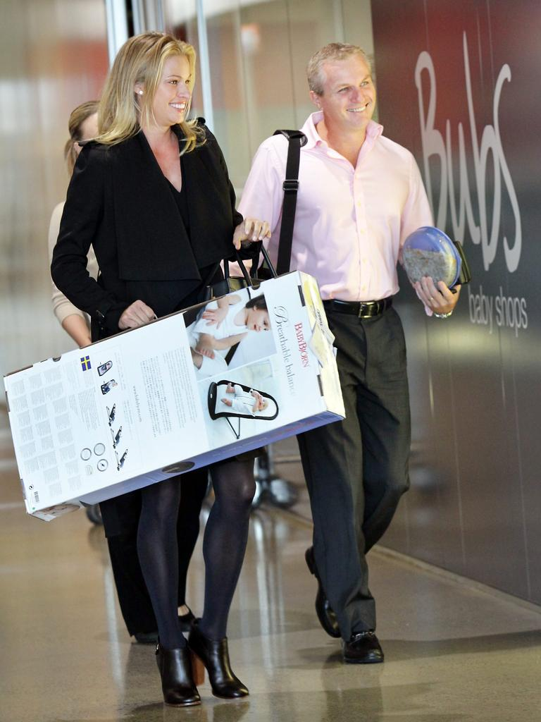 BETTER DAYS: Pregnant supermodel Kristy Hinze, left, carries a Baby Bjorn she purchased from her brother Guy Hinze's baby store in the Homemaker Centre, Fortitude Valley, back in 2011. Photographer: Jodie Richter. Reporter: Hannah Davies.