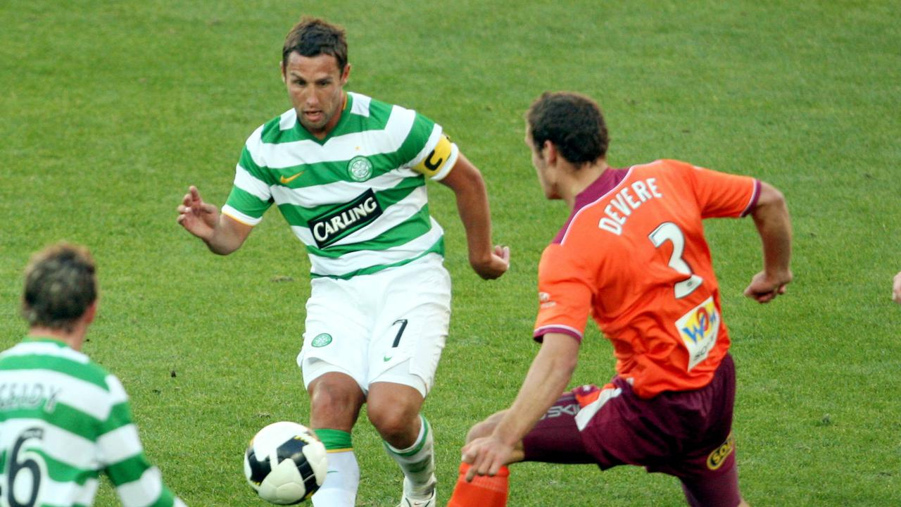 Then Celtic striker Scott McDonald in battle with then Brisbane Roar defender Luke DeVere in 2009.