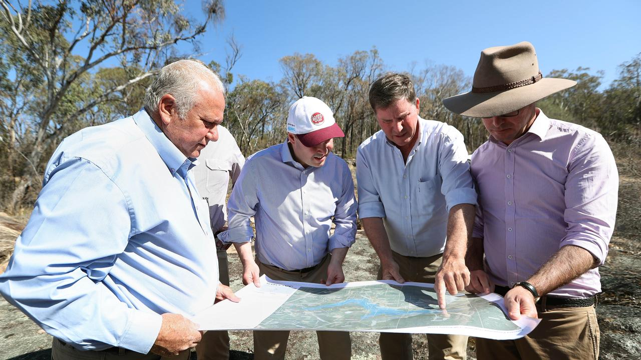 Vic Pennisi, Director of Emu Swamp Dam Pty Ltd, Treasurer Josh Frydenberg with Brent Finlay, independent Chair of the Emu Swamp Dam Committee and Minister for Drought and Water Resources David Littleproud at the site of the proposed dam. The dam remains the only major development in the area on the horizon.