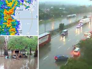Qld weather: Super cell dumps 145mm closing major roads