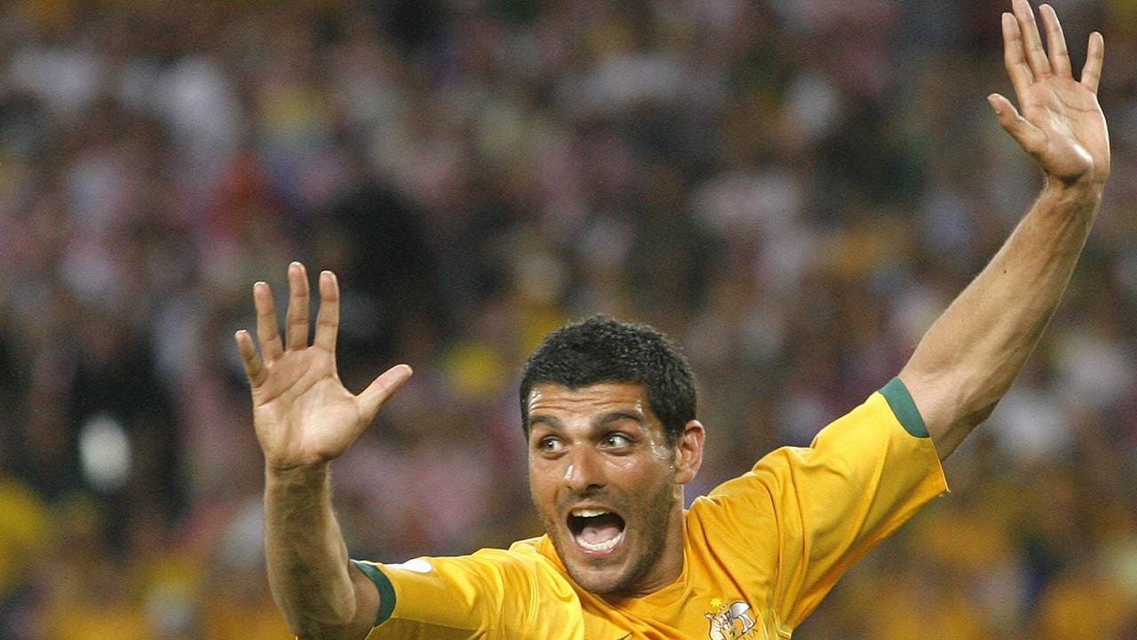 John Aloisi celebrates scoring for Australia at the 2006 FIFA World Cup.