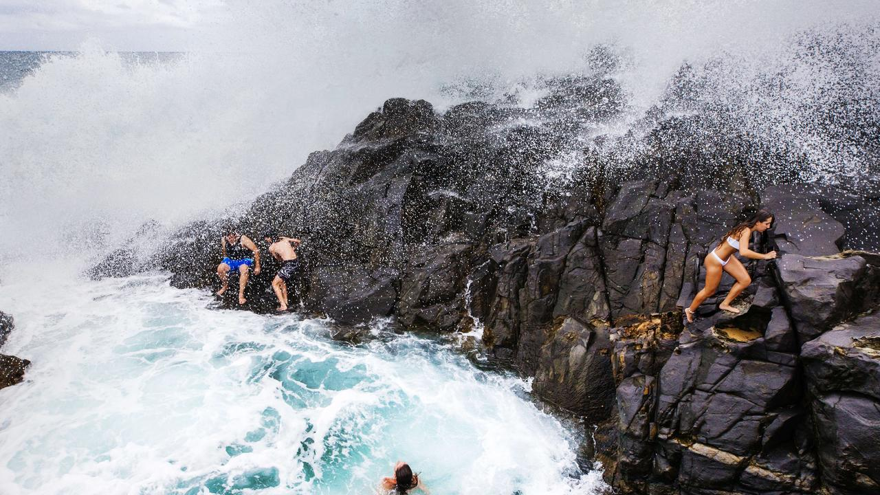 Wild waves crashing into rocks send beachgoers scrambling for safety at Noosa Fairy Pools. Photo Lachie Millard