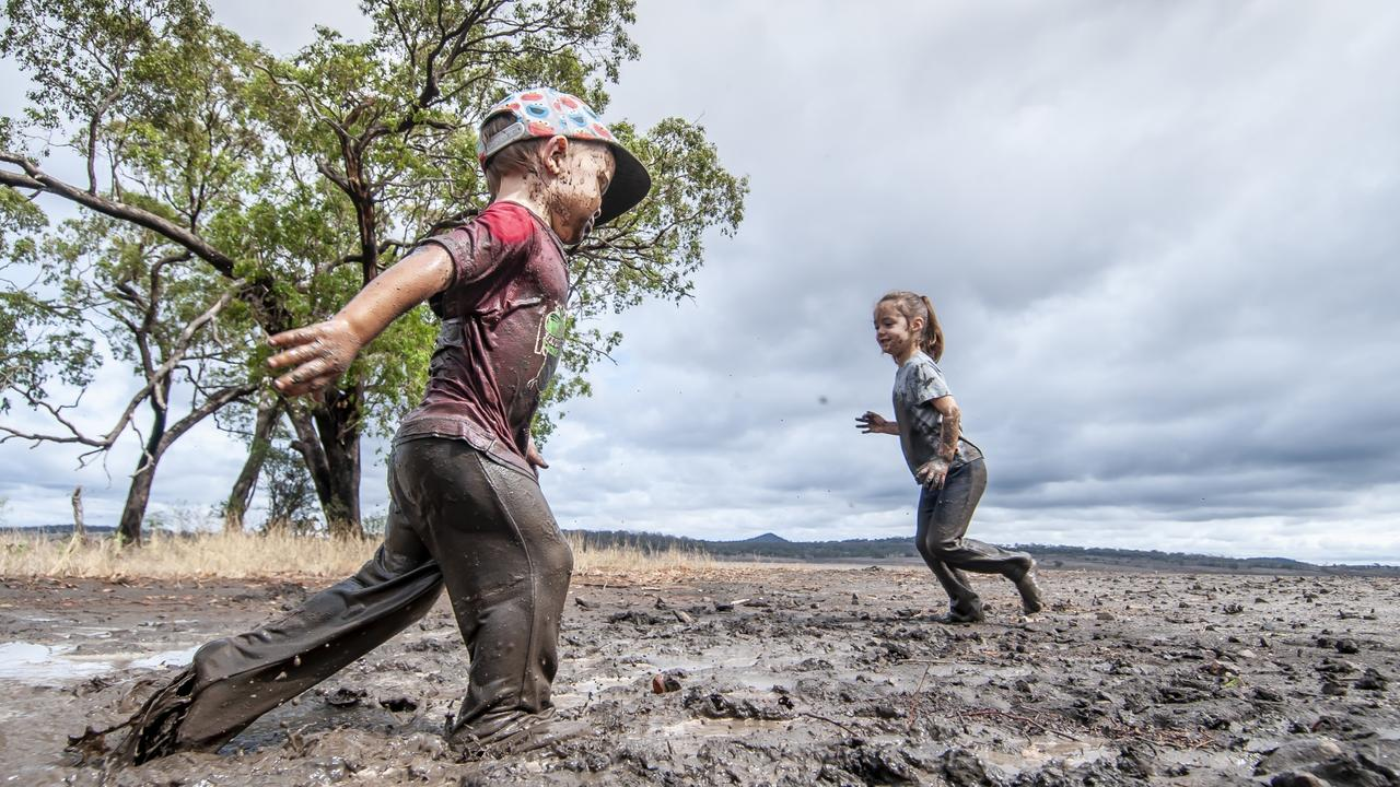 It didn't take Jack and Erin Fuhlbohm long to find a few muddy puddles to play in. Picture: David Martinelli