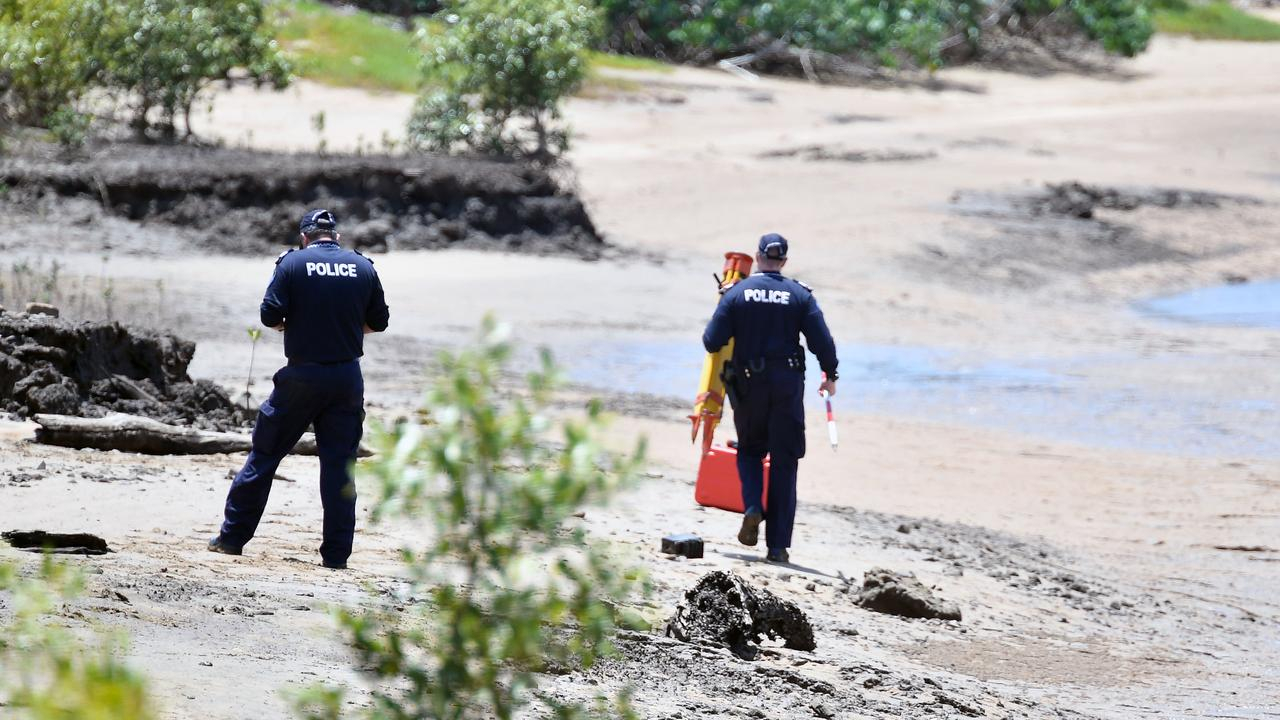 Police including forensic officers searched the banks of the Pioneer River for more bones.