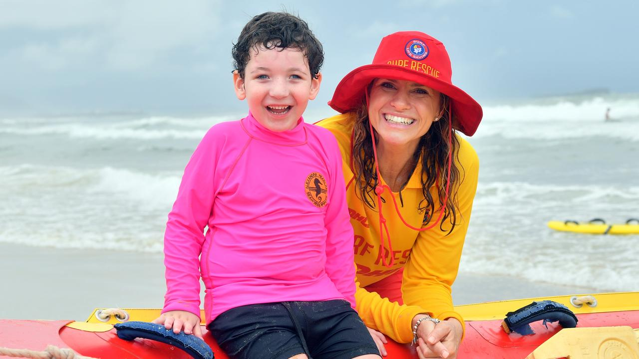 Jodie O'Rourke with Cody Chamings, 5 on Alexandra Headland Beach helping children with disabilities Photo: John McCutcheon / Sunshine Coast Daily
