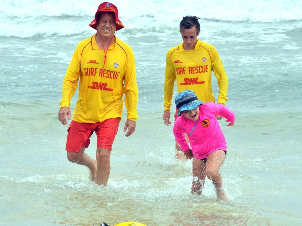 Lachlan having fun with Oscar Hough and Shaun O'Rourke on Alexandra Headland Beach helping children with disabilities Photo: John McCutcheon / Sunshine Coast Daily