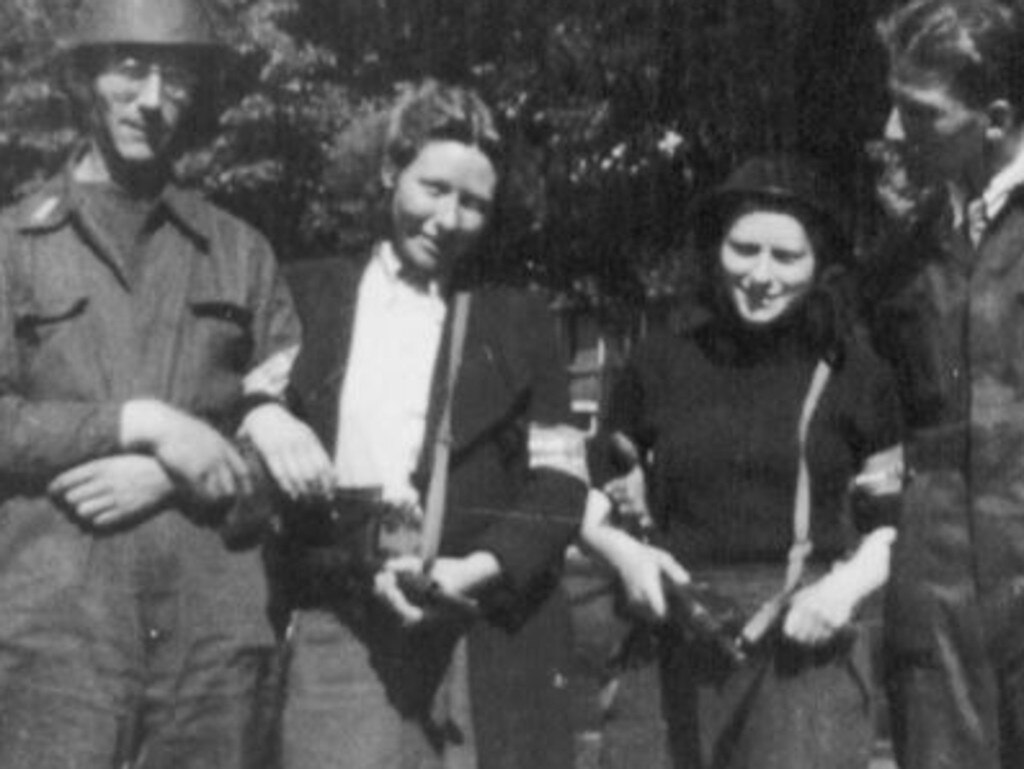 Truus, left, and Freddie pose with other resistance fighters at the end of World War II. Picture: Hannie Schaft Foundation
