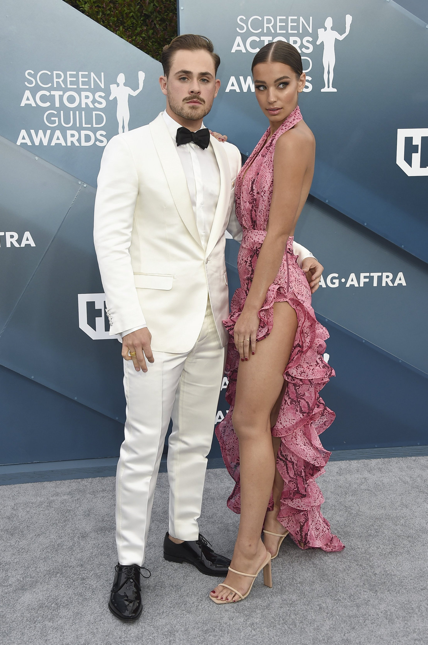 Dacre Montgomery, left, and Olivia Pollock arrive at the 26th annual Screen Actors Guild Awards in Los Angeles.