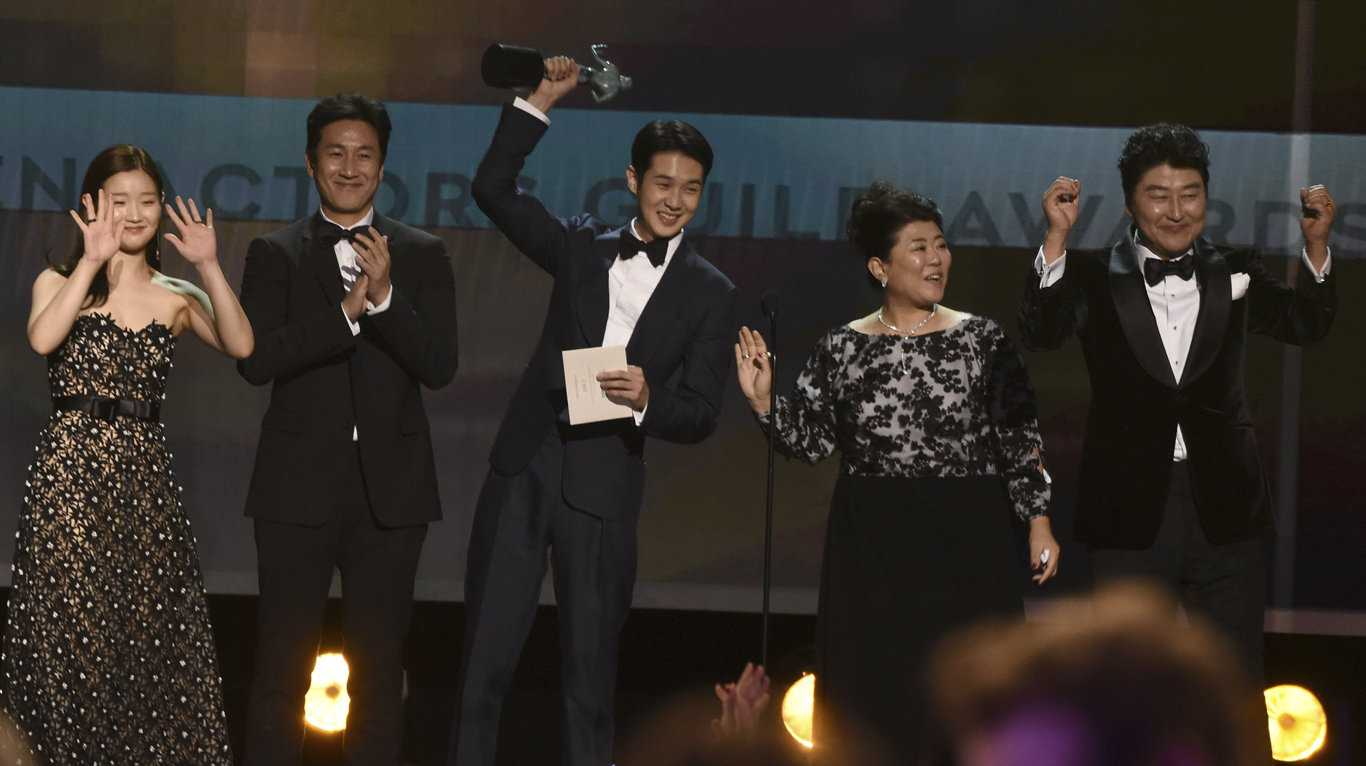 The stars of Parasite accept the award for outstanding performance by a cast in a motion picture at the Screen Actors Guild Awards in Los Angeles.