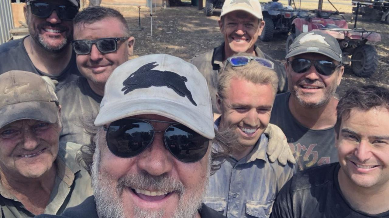 Russell Crowe with neighbours in burnt areas of Nana Glen.