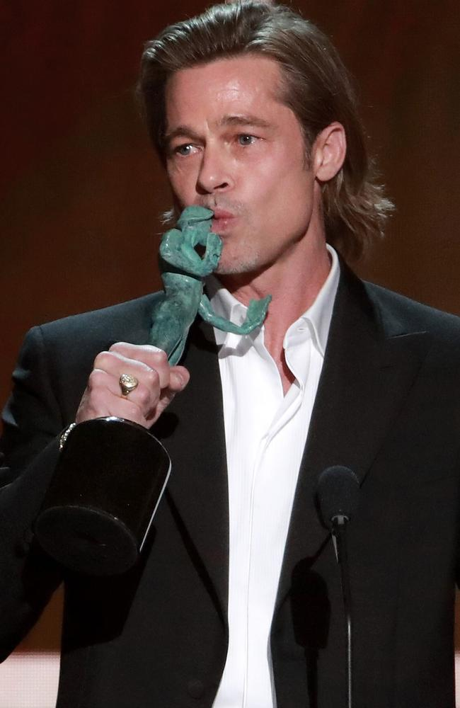For his Tinder profile ... Brad Pit with his SAG Award. Picture: Getty Images