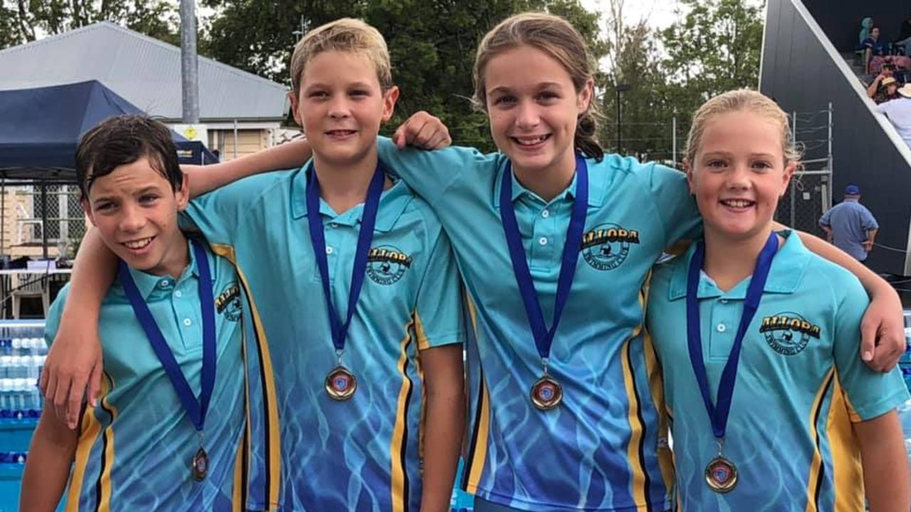 HISTORIC WIN: Will Day, Bailey Harm, Claire Eckersley, Chloe Harm swam into Allora history books winning the 12 and under relay at the Country Championships.