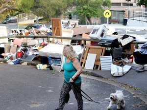 Massive junk pile angers commuity
