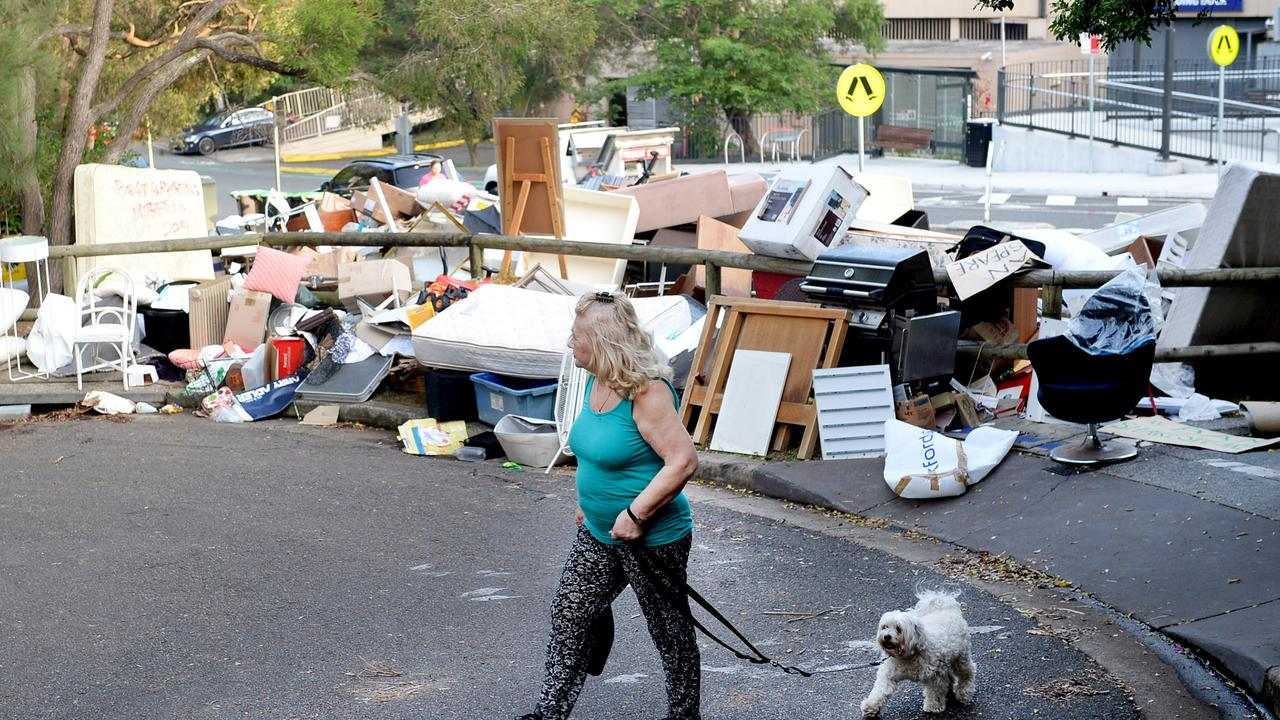 An enormous pile of rubbish which accumulated for days behind a NSW shopping centre for council pick-up has disgusted residents.
