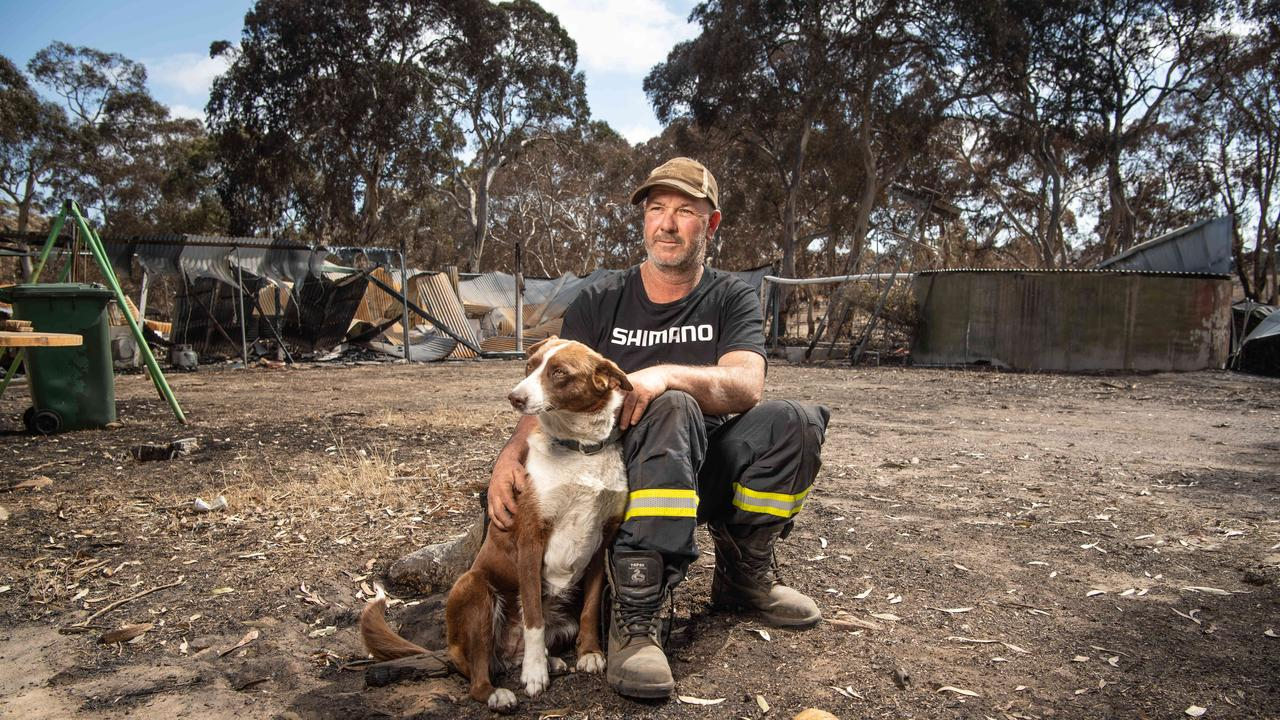 "Shane Leahy with his dog ""Socks"". Picture: Brad Fleet"