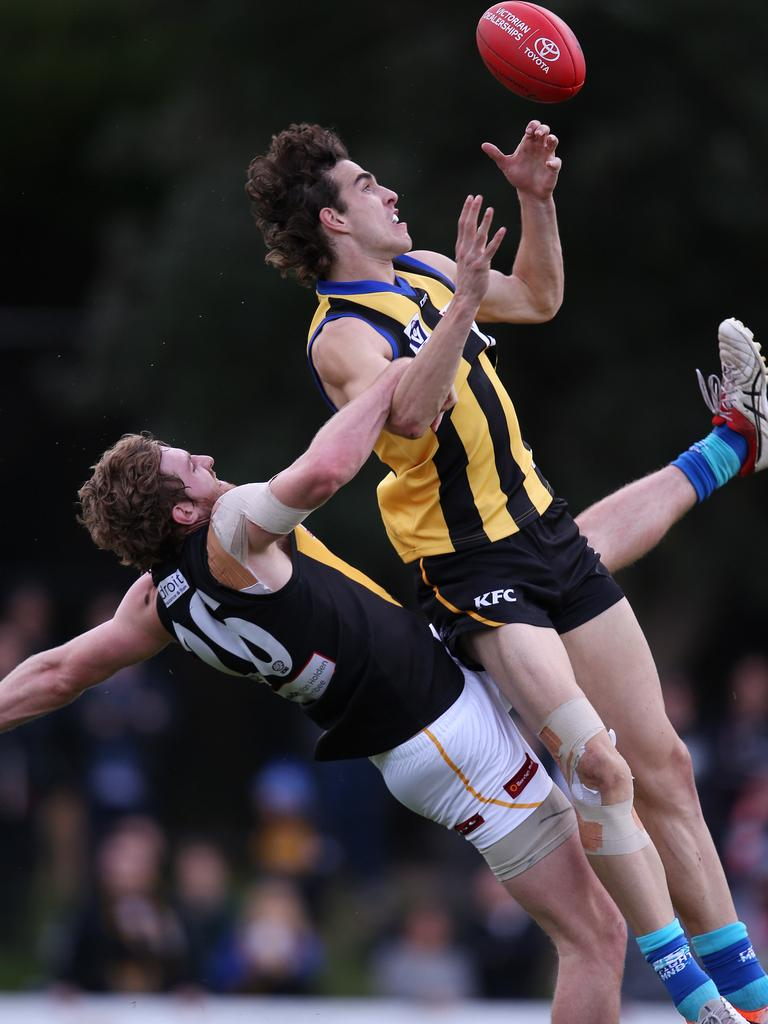 Max King flies for a mark in the VFL for Sandringham.