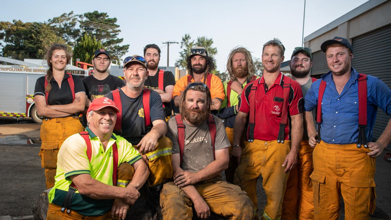 Shane surrounded by fellow Parndana CFS brigade crew. Picture: Brad Fleet